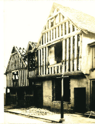 Postcard showing the demoltition of Devere House